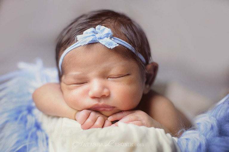 Newborn posed photography Sydney. Baby girl photo portrait in studio